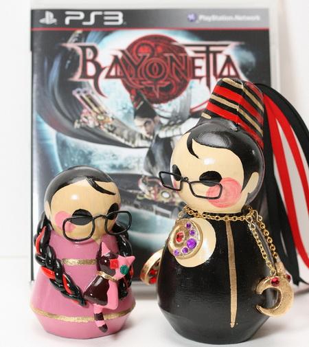 Bayonetta и Cereza на фоне PS3 диска